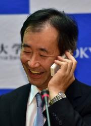 Takaaki Kajita a reçu un appel de félicitations... (PHOTO AFP) - image 2.0