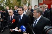 De gauche à droite: le ministre de l'Intérieur,... (PHOTO MEHDI FEDOUACH, AFP) - image 3.0