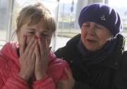 La douleur est vive chez les proches des... (AFP, Olga Maltseva) - image 1.0