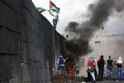 Mercredi, alors que Palestiniens et Israéliens d'affrontent, un... (Photo AHMAD GHARABLI, archives AFP) - image 2.0