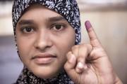 Un petit doigt couvert d'encre violette : une... (AFP, Nicolas Asfouri) - image 4.0