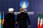 Les présidents Rohani et Poutine, lors du FPEG,... (PHOTO ATTA KENARE, AFP) - image 2.0