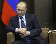 Vladimir Poutine a dénoncé un «coup de poignard... (PHOTO REUTERS) - image 2.0