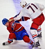 NathanBeaulieu a reçu unesolide droite de Nick Foligno... (Photo André Pichette, La Presse) - image 2.0