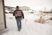 Duane Ehmer, membre de la milice marche sur... (Agence France-Presse) - image 2.0