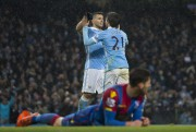 David Silva (21) et Sergio Aguero célèbrent.... (PHOTO JON SUPER, AP) - image 1.0