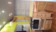 Le comptoir de cuisine a deux panneaux rabattables.... (PHOTO FOURNIE PAR MAISONS OPTIMUM) - image 1.0