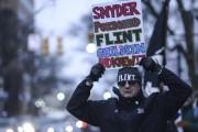 Les excuses du gouverneur du Michigan Rick Snyder... (AP, Junfu Han) - image 2.0