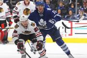 Le coach des Maple Leafs Mike Babcocka mis... (AFP, Claus Andersen) - image 3.0