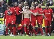 Adam Lallana (au centre) a marqué le but... (PHOTO LINDSEY PARNABY, AFP) - image 2.0