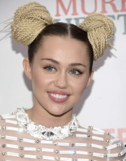 Miley Cyrus... (AP, Evan Agostini) - image 4.0