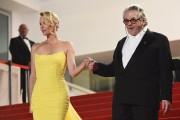 George Miller à Cannes l'an dernier avec Charlize... (AFP, Anne-Christine Poujoulat) - image 4.0