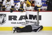 Aucune pénalité n'a été décernée sur la séquence... (La Presse Canadienne, Jeff McIntosh) - image 2.0