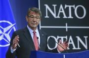 Le secrétaire américain à la Défense Ashton Carter... (PHOTO YVES HERMAN, REUTERS) - image 4.0