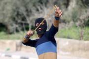 Des centaines de jeunes Palestiniens ont affronté à... (PHOTO MOHAMAD TOROKMAN, REUTERS) - image 1.0