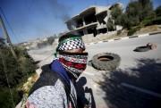 Des centaines de jeunes Palestiniens ont... (PHOTO MOHAMAD TOROKMAN, REUTERS) - image 2.1
