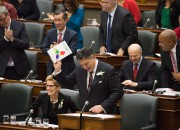 Ontario Finance Minister Charles Sousa, right, delivers the... - image 1.0