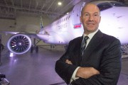 Bombardier chief executive Alain Bellemare poses for photos... - image 1.1