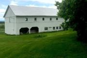 Bien positionnée, la grange protège la maison des... (PHOTO FOURNIE PAR ATELIER PIERRE THIBAULT) - image 1.0