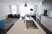 Lorsque l'habitation occupe les deux niveaux inférieurs de... (PHOTO PATRICK SANFAÇON, LA PRESSE) - image 1.0