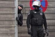Deux suspects ont été blessés vendredi lors d'une... (AP Photo/Geert Vanden Wijngaert) - image 1.0