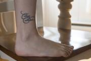 Comme en fait foi le tatouage sur sa... (Stéphane Lessard) - image 2.0