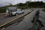La Croix-Rouge espagnole a lancé un appel à... (AP, Dolores Ochoa) - image 2.0