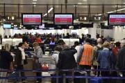 Avec 225 vols prévus mardi, l'aéroport fonctionne en... (AFP, Eric Lalmand) - image 2.0