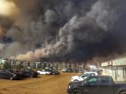 Avec les violents incendies qui font rage dans... (Photo Le Droit) - image 1.1