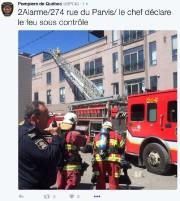 Un incendie sur la terrasse d'un haut bâtiment... (Twitter) - image 1.0