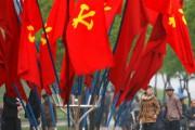 À l'approche du congrès, des drapeaux du PTC,... (Photo Damir Sagolj, Reuters) - image 2.0