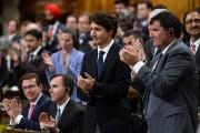 Le premier ministre Justin Trudeau et ses collègues... (Photo Sean Kilpatrick, PC) - image 1.0