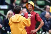 Novak Djokovic s'est adressé aux spectateurs affublé d'un... (Photo Philippe Lopez, AFP) - image 2.0
