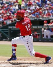 Jurickson Profar des Rangers du Texasa cogné au... (AP, Tony Gutierrez) - image 3.0
