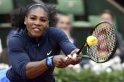 Avec 28,9 millions $,Serena Williams est la sportivela... (AFP, Philippe Lopez) - image 2.0