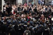 Plus d'une dizaine de personnes ont été interpellées... (AP) - image 2.0