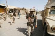 Les forces irakiennes ont hissé vendredi le... (PHOTO Thaier Al-Sudani, REUTERS) - image 3.0