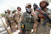 Les forces irakiennes ont hissé vendredi le drapeau... (PHOTO Thaier Al-Sudani, REUTERS) - image 1.0