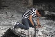Un Irakien réagit alors qu'il entre dans un... (AFP, Ahmad Al-Rubaye) - image 2.0