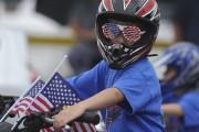 Ce jeune affichait clairement ses couleurs lors d'une... (AP, Jay Diem) - image 2.0