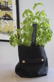Une nouveauté, le P'tit bag, qui peut servir... (Fournie par Quatre murs et un toit) - image 1.0