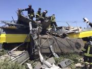 Vingt-deux personnes au moins ont trouvé la mort et... (AP, Massimo Mazzilli) - image 2.0