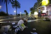 À l'aube, la Promenade des Anglais présentait une... (Photo AP, Luca Bruno) - image 1.0