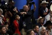 Des délégués ont manifesté bruyamment contre l'adoption durèglement... (AFP, Dominick Reuter) - image 2.0