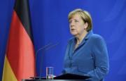 Angela Merkel en conférence de presse, samedi.... (AFP, TOBIAS SCHWARZ) - image 2.0