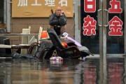 Des inondations causées par des pluies torrentielles ont... (AP) - image 1.1