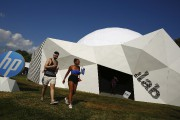 People walk pass by The Lab, a tent... (AFP, Kena Betancur) - image 2.0