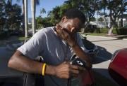 Jean Robert Archilles, père d'une des deux victimes,... (AP, Andrew West) - image 2.0