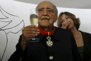 Brazil's architect Oscar Niemeyer holds a glass of... (AP) - image 3.0