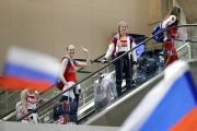Des membres de l'équipe olympique russe sont accueillis... (photo Patrick Semansky, AP) - image 1.0